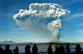 People watch from Puerto Varas southern Chile a high column of ash and lava spewing from the Calbuco volcano on April 22 2015 Chile's Calbuco volcano...