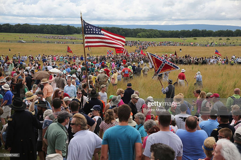 People watch from the Cemetery Hill as thousands of people re-enact Pickett's Charge on the 150th anniversary of the historic Battle of Gettysburg on July 3, 2013 in Gettysburg, Pennsylvania . The Rebel charge, which occurred on July 3, 1863, the last day of the three-day battle, was a decisive Union victory and widely considered the turning point in the American Civil War. Federal and Confederate armies suffered a combined total of 51,000 casualties over three days, the highest number of any battle in the four-year war.