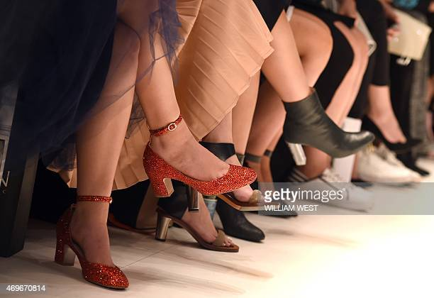 People watch models parade garments by Australian designer Jayson Brunsdon during a parade at Fashion Week Australia in Sydney on April 14 2015 AFP...