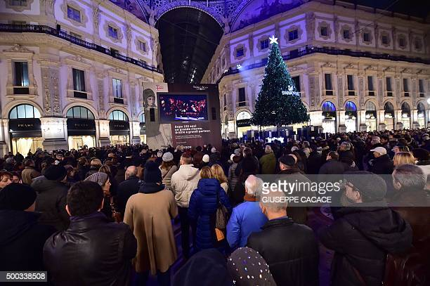 People watch on a giant screen set up in Vittorio Emanuele gallery the Premiere of Giovanna d'Arco by Giuseppe Verdi for the season opener of La...