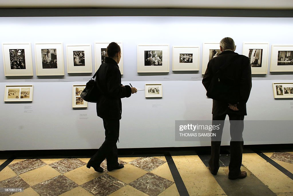 People watch photographs of Brassai during the exhibition entitled 'Brassai, pour l'amour de Paris' ('Brassai, for the love of Paris') at the Hotel de Ville of Paris, on November 6, 2013.