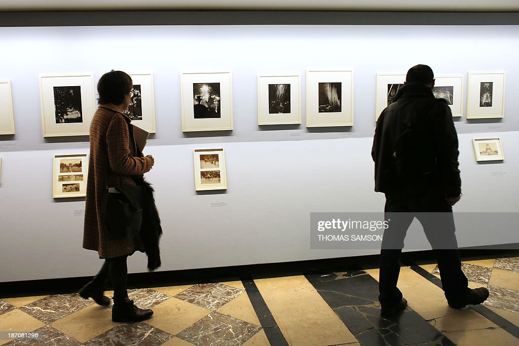 People watch photographs of Brassai during the exhibition entitled 'Brassai, pour l'amour de Paris' ('Brassai, for the love of Paris') at the Hotel de Ville of Paris, on November 6, 2013.