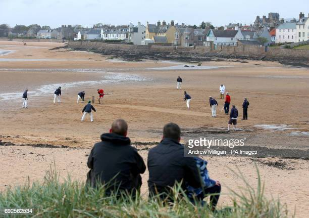 People watch the beach cricket match in Elie between the Ship Inn cricket team in Elie Fife and Eccentric Flamingos CC The Ship Inn are the only pub...