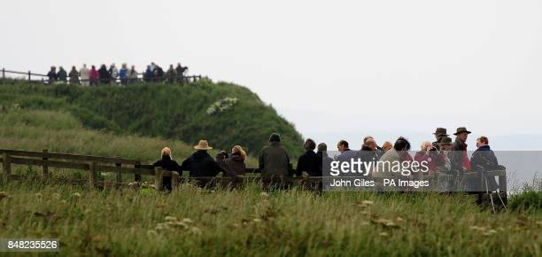 People watch the birds from the cliffs at the RSPB Nature Reserve at Bempton Cliffs near Bridlington where around 250000 seabirds including Gannets...
