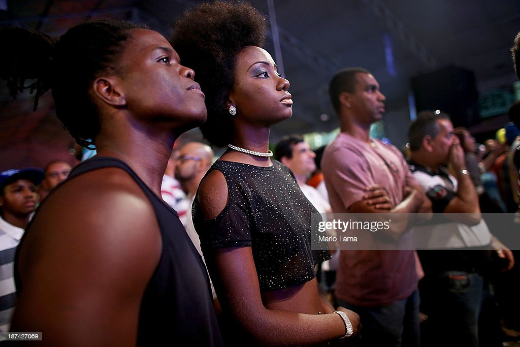 People watch the ceremony deciding Rio's 2014 Carnival Queen and King in the port district on November 8, 2013 in Rio de Janeiro, Brazil. Rio's Carnival runs February 28 through March 4, just three months before the start of the 2014 FIFA World Cup in June.