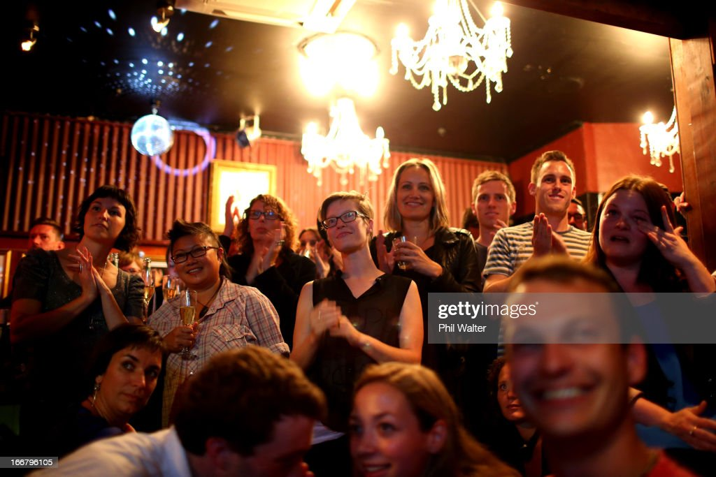 People watch the final reading on Parliament TV at the Caluzzi Bar and Cabaret venue as New Zealand MP's gathered today to vote on the gay marriage bill at Parliament House on April 17, 2013 in Auckland, New Zealand. The Marriage Equality Bill, proposed by Labour MP Louisa Wall, passed the vote, meaning same-sex marriage will soon be legal in New Zealand.