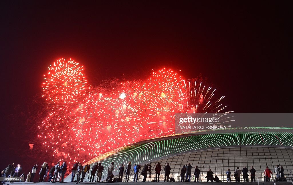 People watch the fireworks exploding over the Russian Black Sea resort of Sochi, on February 7, 2013, to celebrate the one year countdown to the Sochi 2014 Winter Olympics opening. Putin vowed today Russia would justify expectations when it hosts the Winter Olympic Games in Sochi in one year, after ruthlessly firing an official blamed for delays in building infrastructure.