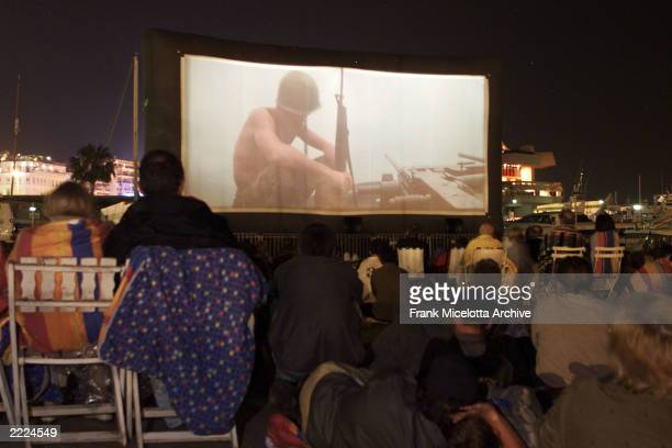 People watch the first outdoor screening of a film Apocalypse Now at the 54th Cannes Film Festival in Cannes France 5/13/01 Photo by Frank...