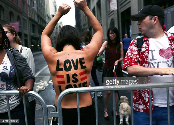 People watch the Gay Pride Parade on June 28 2015 in New York City The parade runs two days after the Supreme Court's landmark decision guaranteeing...