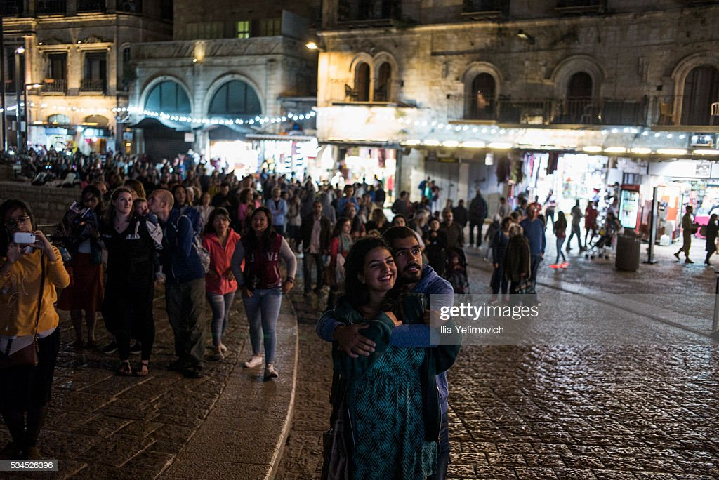 People watch the Light Festival on May 26, 2016 in Jerusalem, Israel. The Light Festival, which features both Israeli and international artists, takes place annually in Jerusalem's Old City and the surrounding areas.