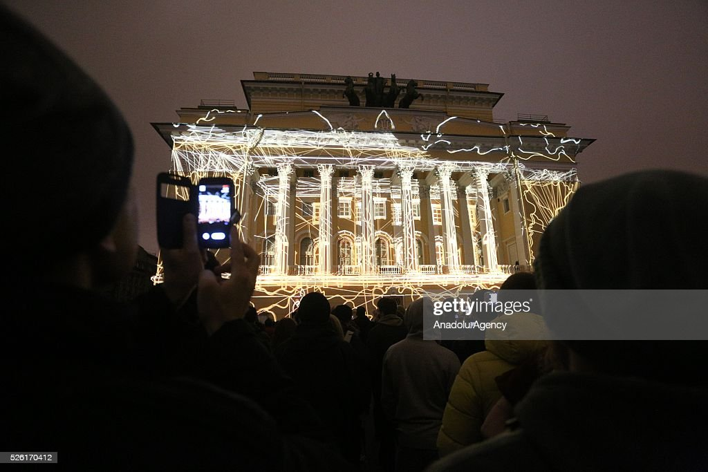 People watch the light projections on the building of the Alexandrinsky theatre during the Light Festival in Saint-Petersburg, Russia on April 29, 2016.
