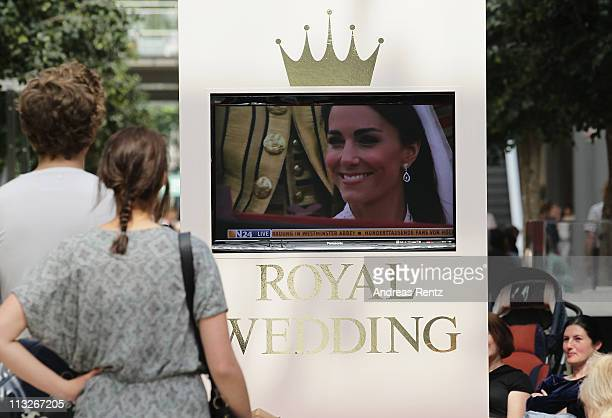 People watch the live broadcast of the Royal Wedding of Prince William to Catherine Middleton at Arcaden at Potsdamer Platz on April 29 2011 in...