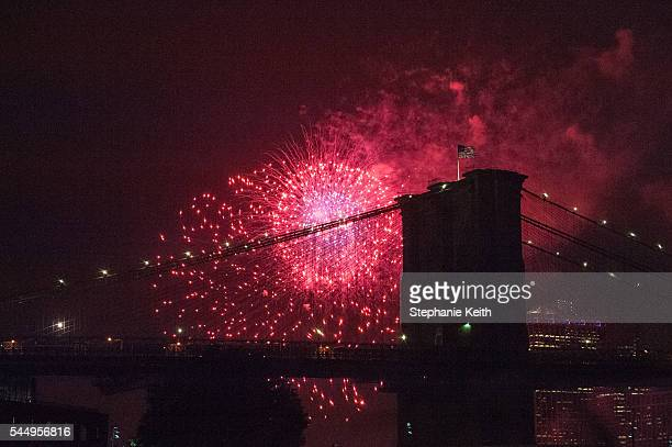 People watch the Macy's Fourth of July Fireworks from Brooklyn Bridge Park on July 4 2016 in the Brooklyn borough of New York City The celebrations...