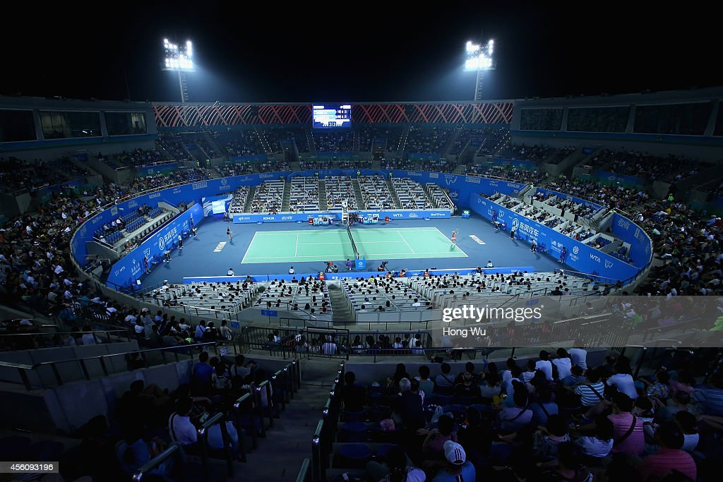 People watch the match during Timea Bacsinszky of Switzerland againsts Caroline Wozniacki of Denmark on day five of 2014 Dongfeng Motor Wuhan Open at...