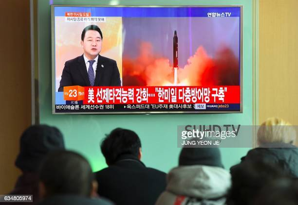 People watch the news showing file footage of North Korea's missile launch at a railway station in Seoul on February 12 2017 North Korea fired a...