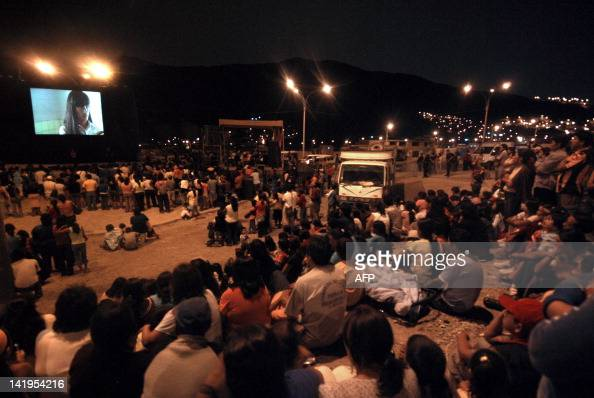 People watch the openair screening of the film 'La Teta Asustada' by Peruvian director Claudia Llosa in the hamlet of ManchayPachacamac outskirts of...
