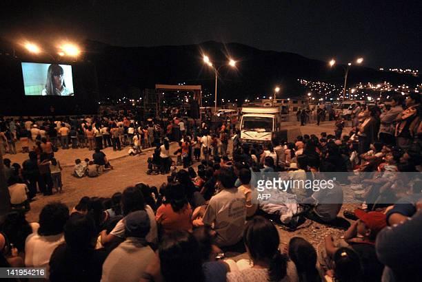 People watch the openair screening of the film 'La Teta Asustada' by Peruvian director Claudia Llosa in the hamlet of ManchayPachacamac outskirts of...