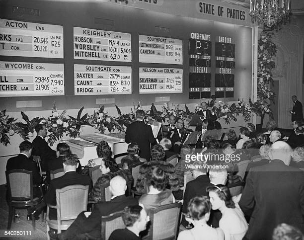 People watch the results come in and listen to a live band during a General Election party being held at the Savoy Hotel London 26th May 1955