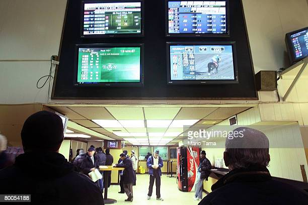 People watch the screens inside an OffTrack Betting parlor in midtown Manhattan February 28 2008 in New York City The board that oversees New York...