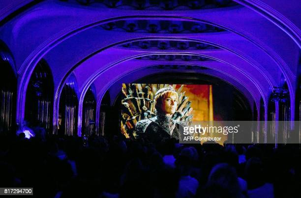 People watch the seventh season premiere of US TV show 'Game of Thrones' at the Mayakovskaya metro station in Moscow early on July 18 2017 'Game of...