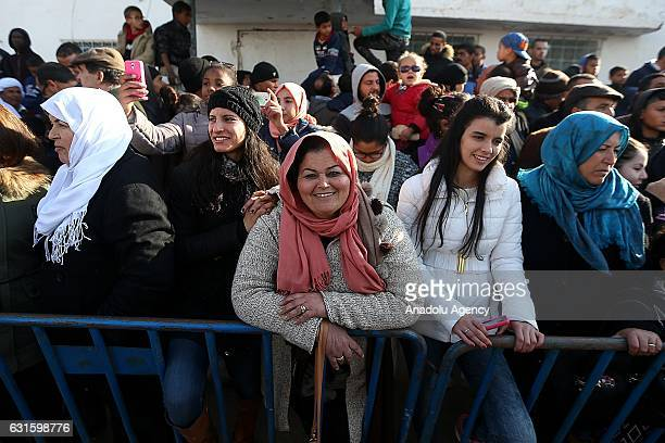 People watch the shows during the opening of International Festival of the Sahara at AlShuhada Square in Douz Kebili Tunisia on January 13 2017 The...