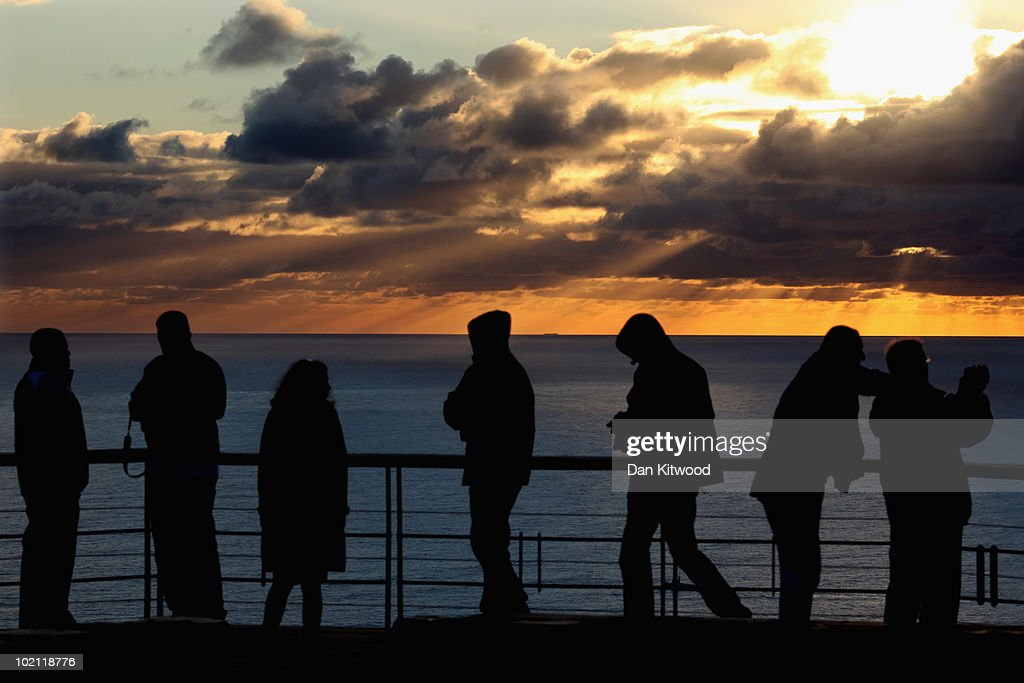 People watch the sun set on Signal Hill on June 15, 2010 in Cape Town, South Africa.