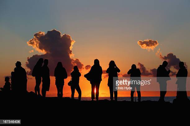 People watch the sunrise during the ANZAC dawn service at Currumbin Surf Life Saving Club on April 25 2013 in Gold Coast Australia Veterans...