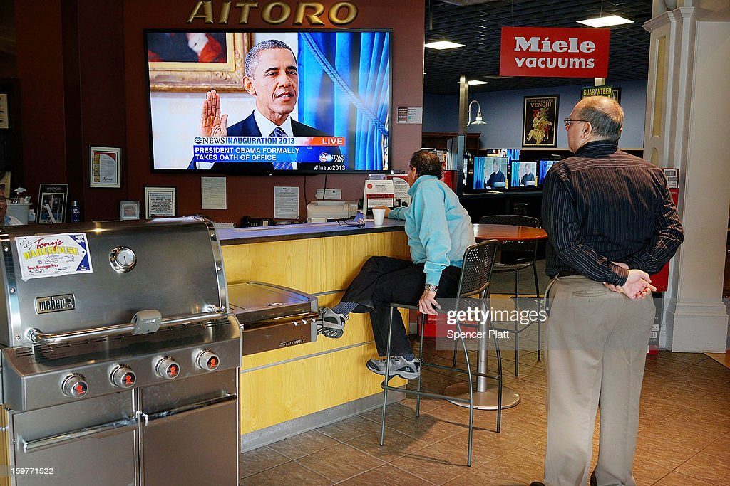 People watch the swearing-in of U.S. President Obama at Aitoro appliance store on January 20, 2013 in Norwalk, Connecticut. Both President Obama and Vice President Biden were formally sworn into office today, marking the official beginning of their second terms in office.