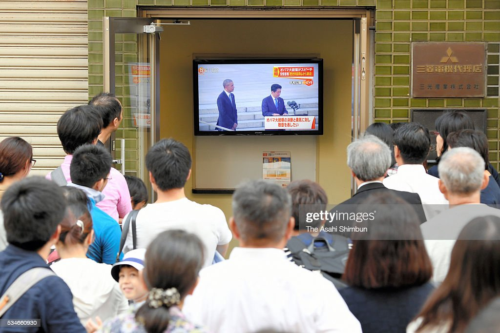 People watch the television news broadcasting the U.S. President Barack Obama's visit to the Hiroshima Peace Memorial Park on May 27, 2016 in Hiroshima, Japan. Obama becomes the first sitting U.S. president to visit Hiroshima, where the first atomic bomb was dropped in 1945 at the end of World War II.