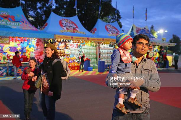 People watch the theme park rides during the 159th annual Royal Melbourne Show at the Royal Melbourne Showgrounds on September 20 2014 in Melbourne...