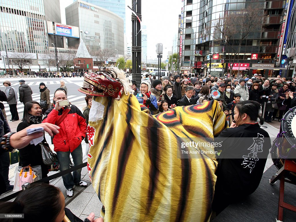 People watch the tiger dance performed by children from Kesennuma on January 5, 2013 in Tokyo, Japan.