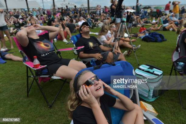People watch the total solar eclipse in Charleston South Carolina on August 21 2017 The Sun started to vanish behind the Moon as the partial phase of...