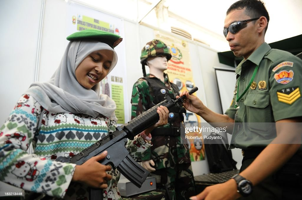 People watch the weapons during the Indonesian Army Weapons Exhibition on October 6, 2013 in Jakarta, Indonesia. This year marks the 68th anniversary of the Republic of Indonesia's Armed Forces.