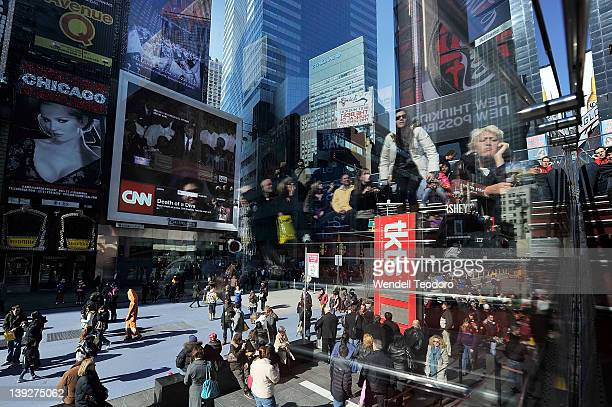 People watch the Whitney Houston funeral on the Jumbotron in Times Square on February 18 2012 in New York City Whitney Houston was found dead in her...
