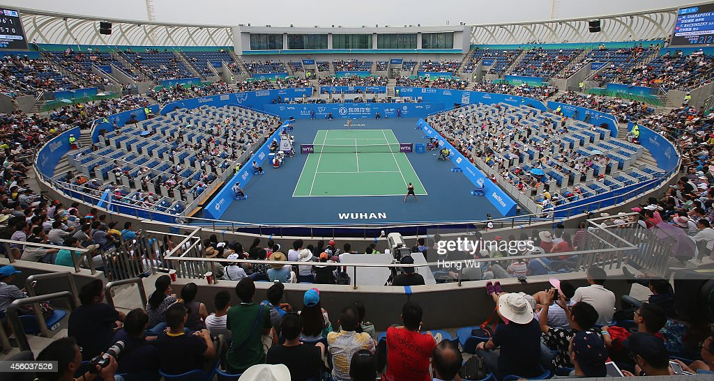 People watch Timea Bacsinszky of Switzerland play Maria Sharapova of Russia on day four of 2014 Dongfeng Motor Wuhan Open at Optics Valley...