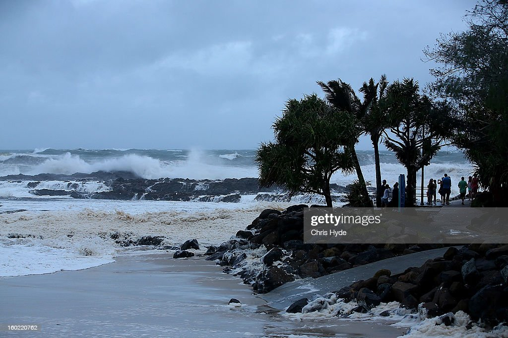 People watch wild conditions at Snapper Rocks as Queensland experiences severe rains and flooding from Tropical Cyclone Oswald on January 28, 2013 in Gold Coast, Australia. Hundreds have been evacuated from the towns of Gladstone and Bunderberg while the rest of Queensland braces for more flooding.