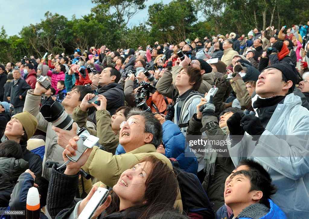 People watches the launch of the H2A-22 rocket, developed by The Japan Aerospace Exploration Agency (JAXA) and Mitsubishi Heavy Industries Ltd. at JAXA's Tanegashima Space Center on January 27, 2013 in Minamitane, Japan. The rocket carries information-gathering radar satellite and optical satellite.
