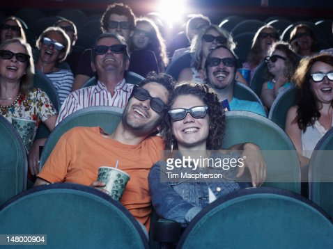 People watching a movie at a theater : Foto de stock