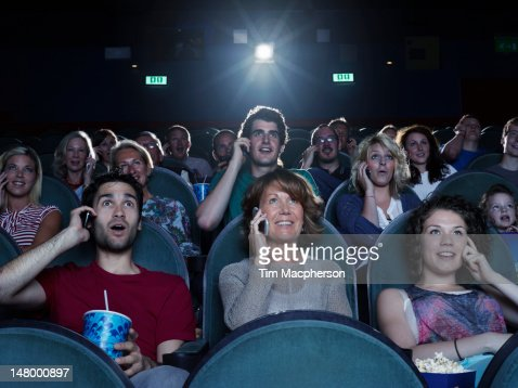 People watching a movie on the phone stock photo getty for People watching