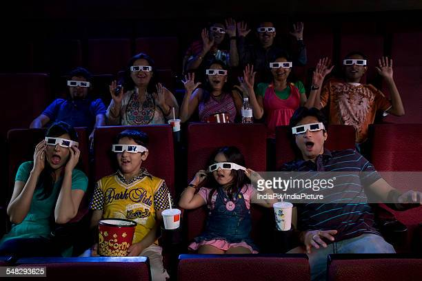 People watching a movie with 3D glasses