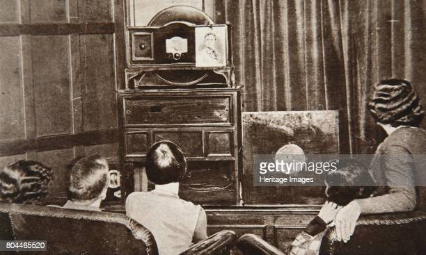 People watching an early television transmission c1920s Developed by Scottish inventor John Logie Baird television was first successfully broadcast...