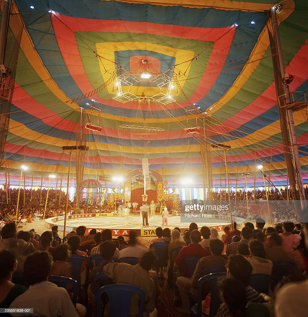 People watching circus in tent : Stock Photo