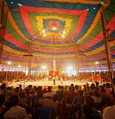 People watching circus in tent