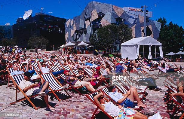 People watching cricket on big screen at Federation Square.