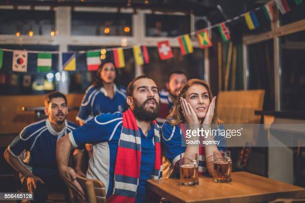 People watching game in pub