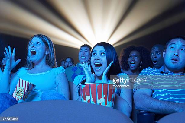 People Watching Horror Movie in Theater