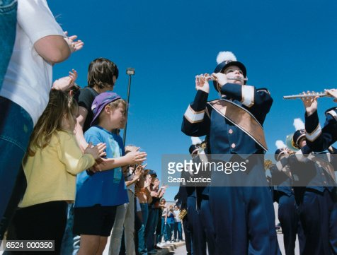 People Watching Marching Band : Stock Photo