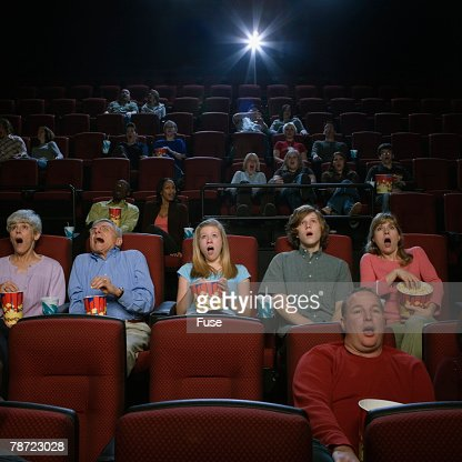 people watching movie in movie theatre stock photo getty