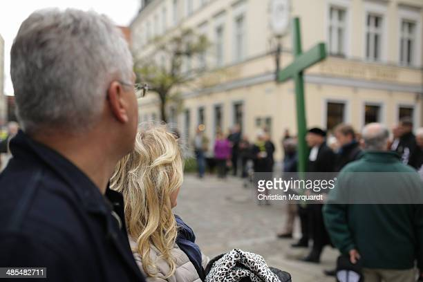 People watching the passing procession during the ecumenical Good Friday procession on April 18 2014 in Berlin Germany Under the theme of...