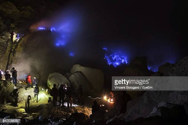 People Watching Volcanic Landscape In Kawah Ijen At Night